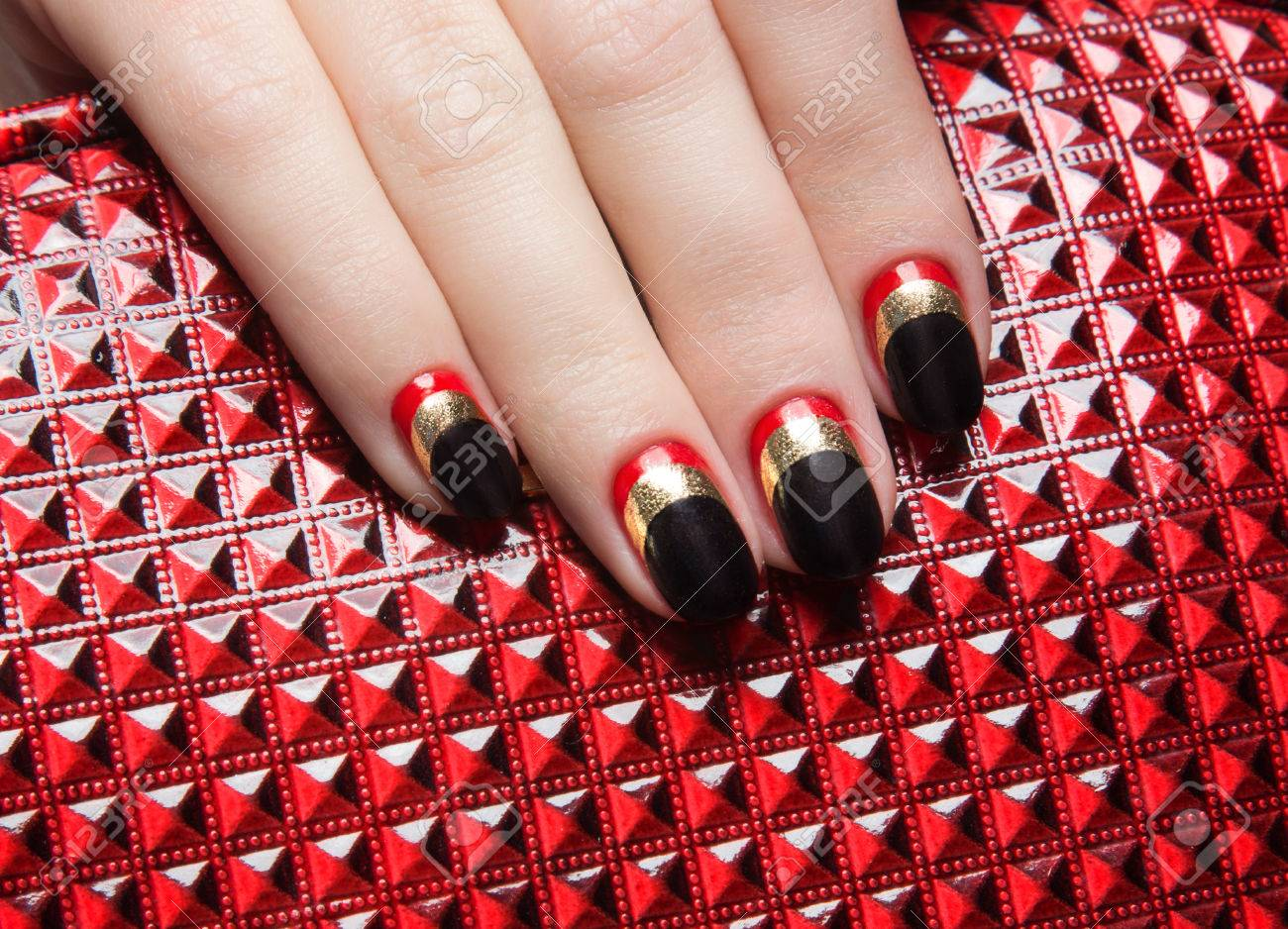 Beautiful Women\'s Manicure With Black, Red, Gold Polish On The ...