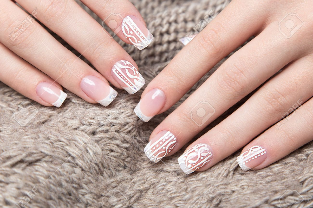 Snow White manicure on female hands. Winter nail design. Picture taken in the studio on a background of wool. - 46452564