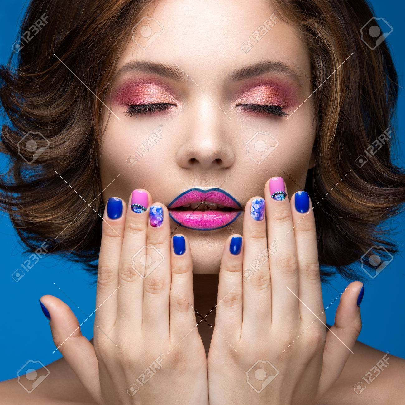 Beautiful Model Girl With Bright Makeup And Colored Nail Polish ...