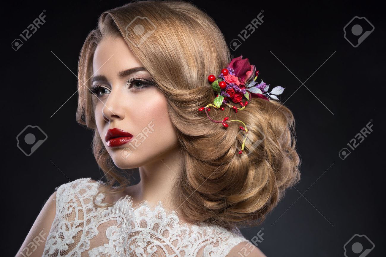 Portrait of a beautiful blond girl  in image of the bride with purple flowers on her head. Beauty face. Photo shot in the Studio on a grey background Stock Photo - 46796241