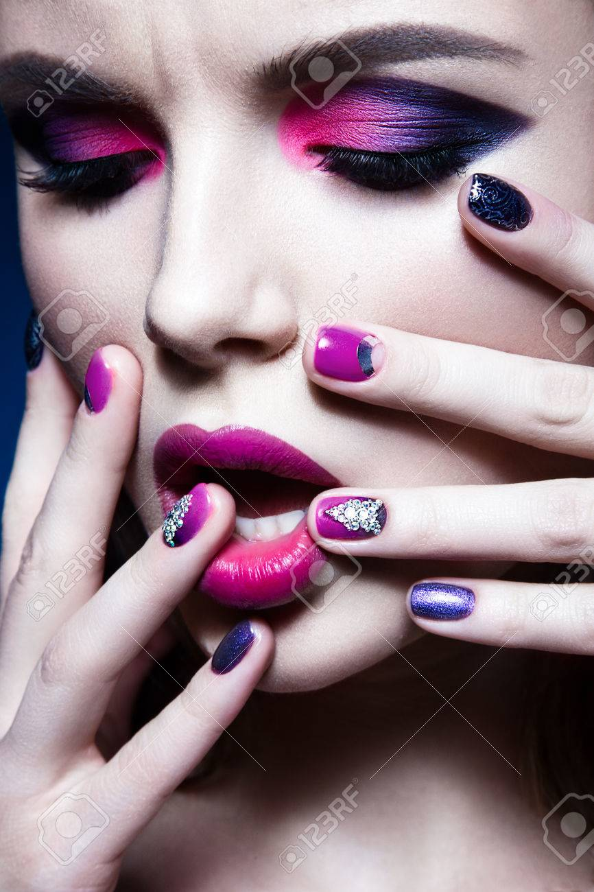 Beautiful girl with bright creative fashion makeup and colorful nail polish. Art beauty design. Beauty face. Studio portrait - 50427701