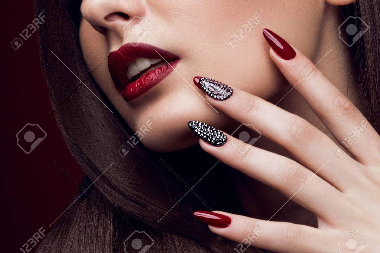 Pretty girl with unusual hairstyle, bright makeup, red lips and manicure design. Beauty face. Art nails. Studio portrait - 50830958