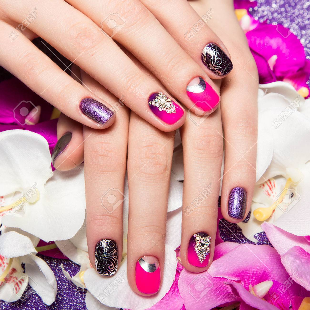 Beautiful colorful manicure with bubbles and crystals on female hand. Close-up. Picture taken in the studio - 51284062