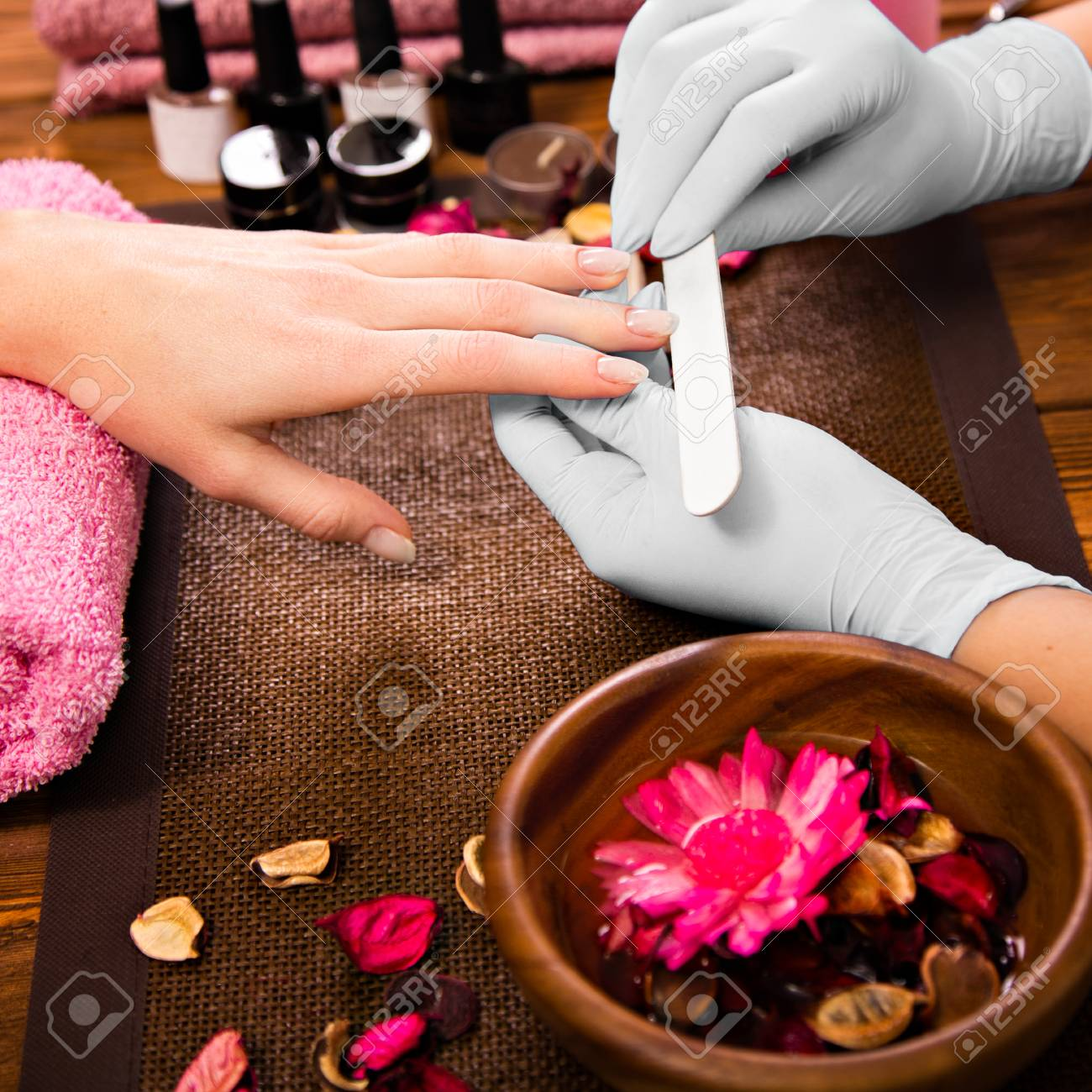 Closeup Finger Nail Care By Manicure Specialist In Beauty Salon ...