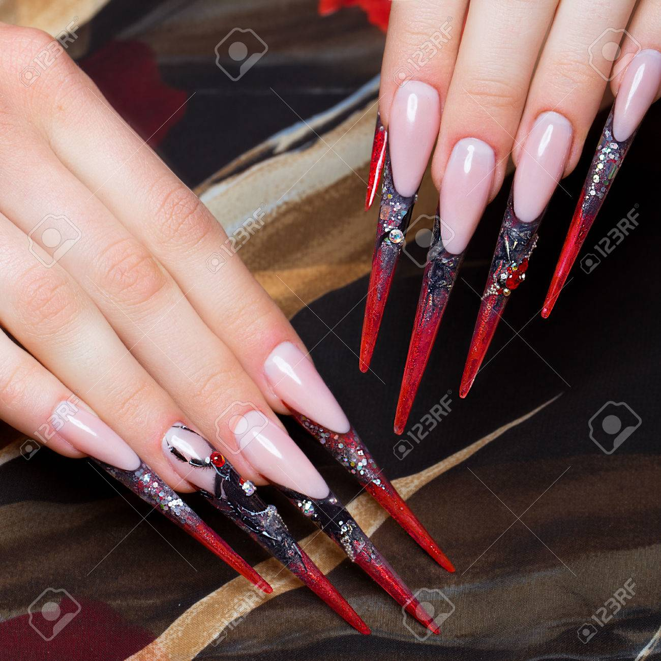 Long Beautiful Manicure On The Fingers In Black And Red Colors ...