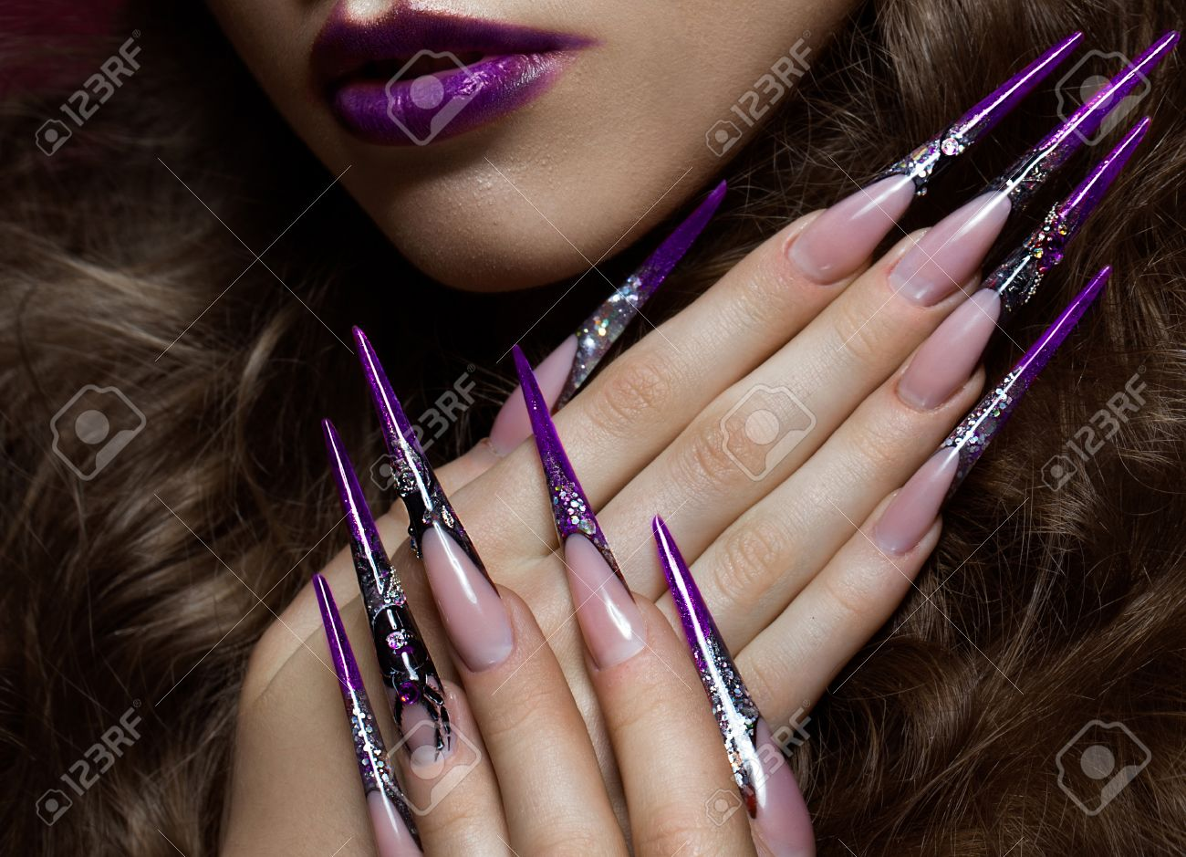Portrait of woman in the image of spider with creative art makeup and long nails. Manicure design, beauty face. Photos shot in studio - 57853903