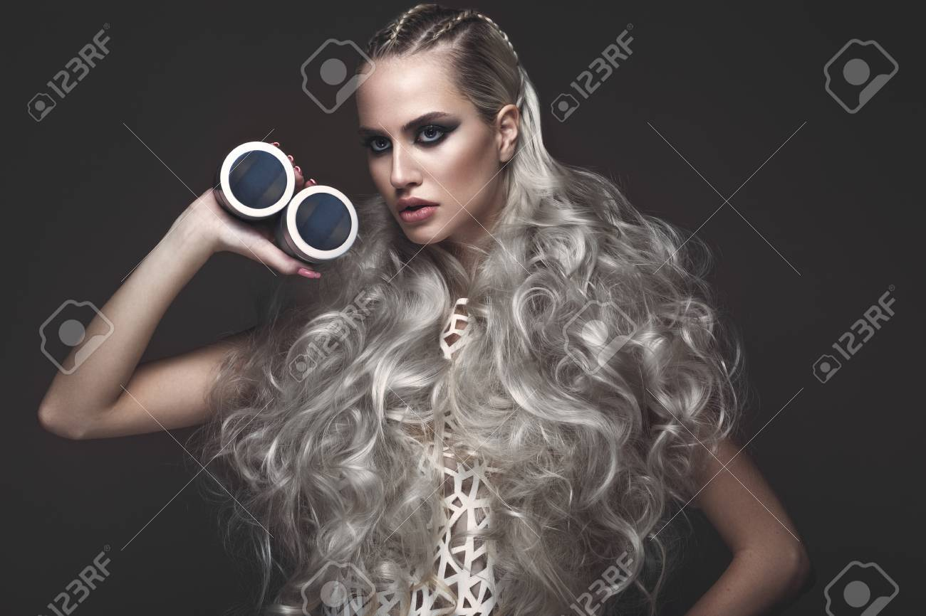 Beautiful Girl In Art Dress And Avant-garde Hairstyles With Cosmetic ...