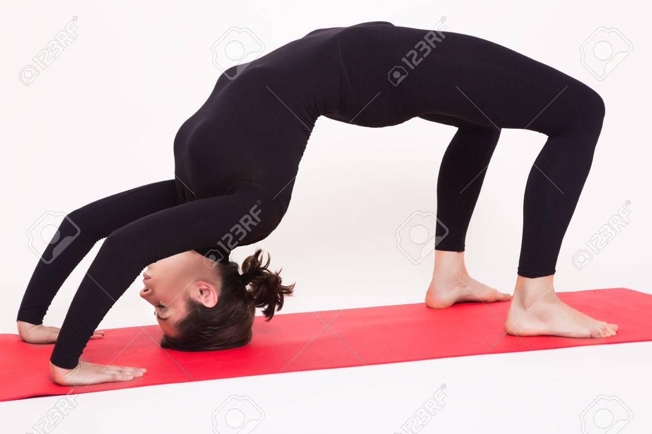 Beautiful Athletic Girl In Black Suit Doing Yoga Asanas Isolated On White Background Stock Photo