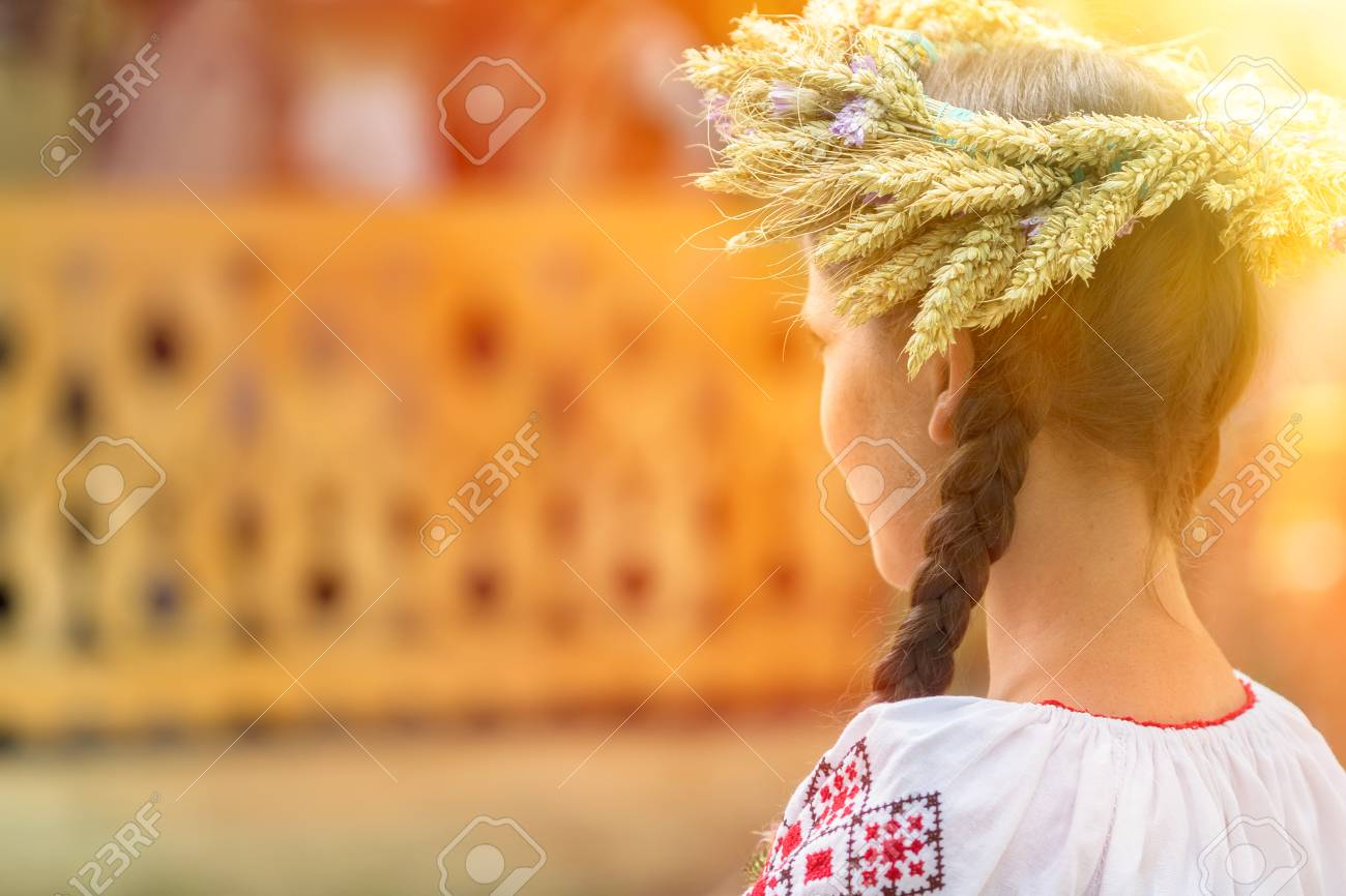 Young Woman Wearing A Braiding Crown Made Of Wheat And Flowers Stock