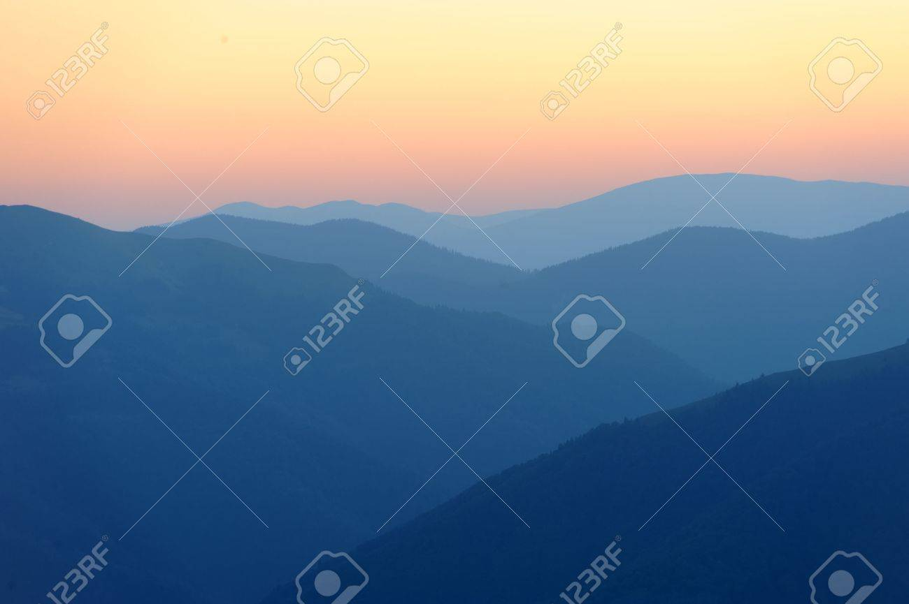 Beautiful sunrise in the mountains with a silhouette of the mountains Standard-Bild - 40240125