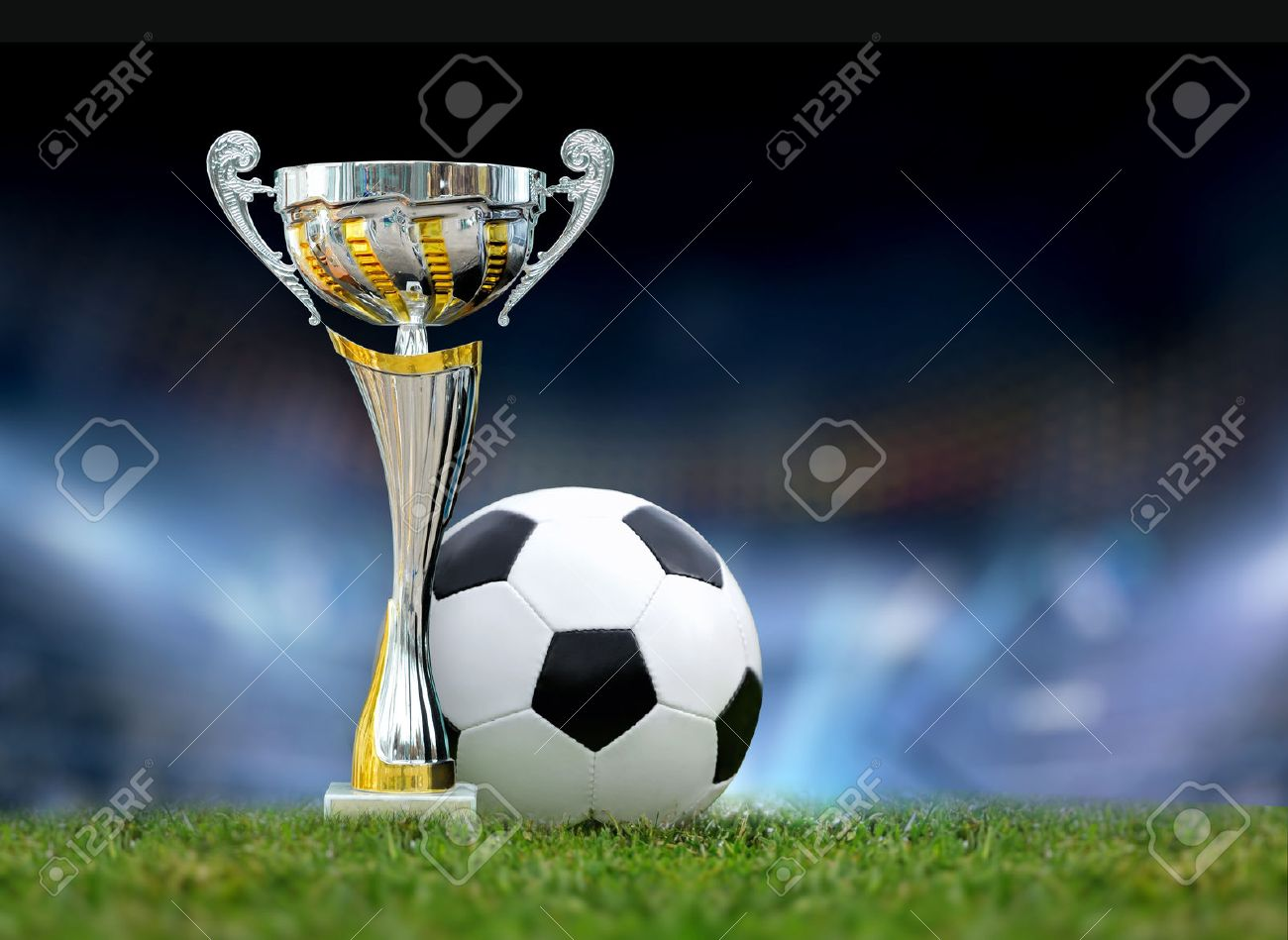 Golden trophy in grass on soccer field background Standard-Bild - 40886519