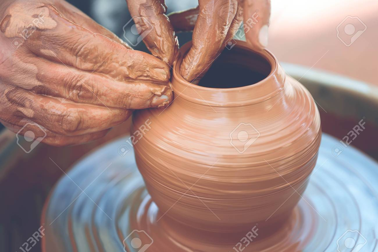 Hands Of A Potter Potter Making Ceramic Pot On The Pottery Wheel
