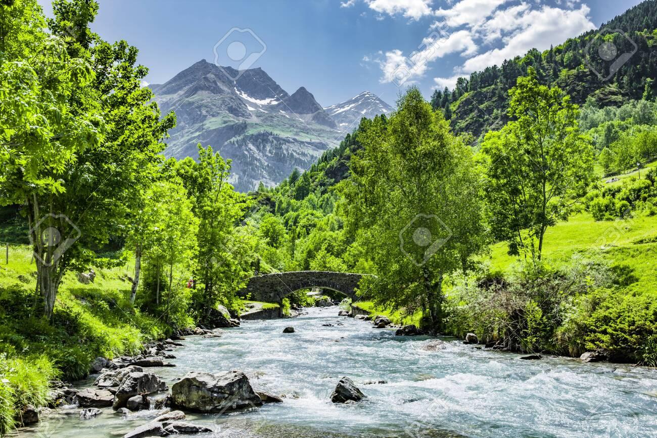 Bridge over the Gave de Gavarnie, French Pyrenees - 128457426