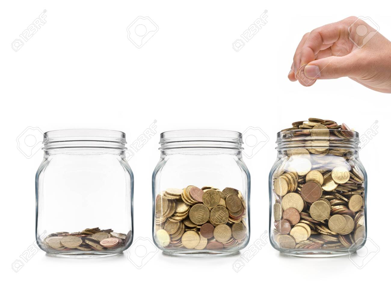 Hand with 5 cents coin and glasses with coins - 137602701