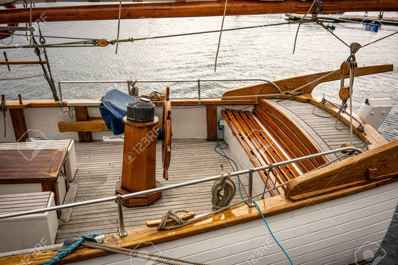 Wooden Boat with clean brown Teak Deck