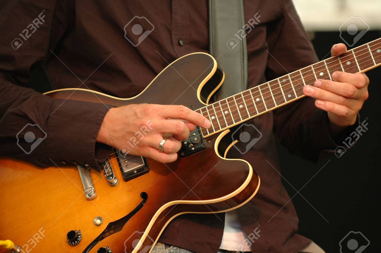 A man is playing his guitar. Stock Photo - 710340