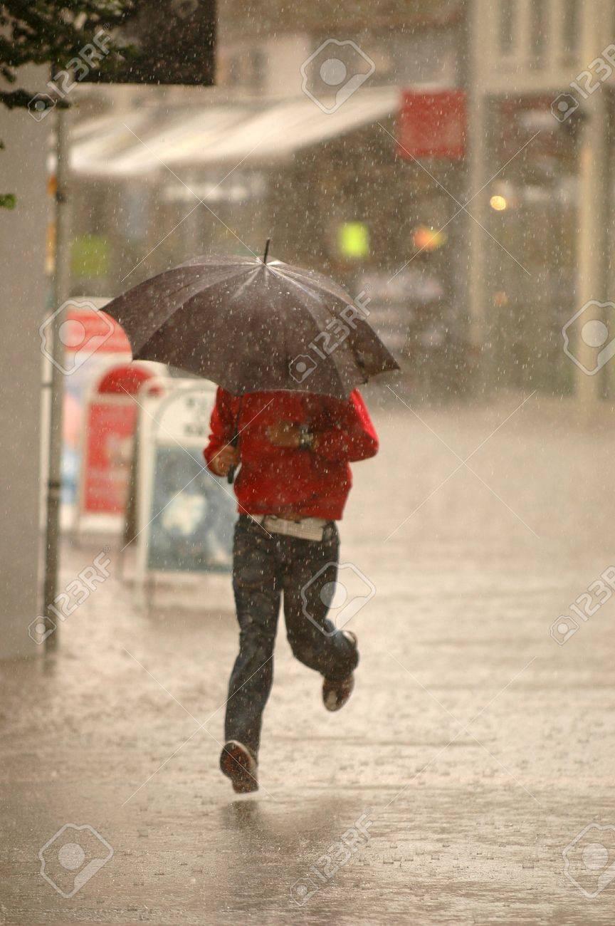 Man running in the rain. Motion blur. Stock Photo - 710333