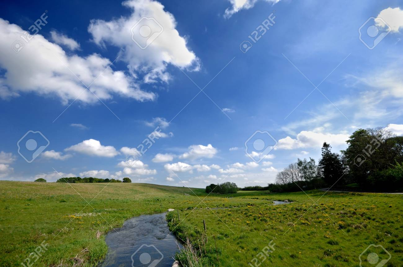 Smalle river and cloudy sky Stock Photo - 2525984