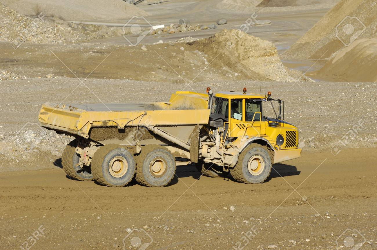 A yellow dump truck is driving in a mine Stock Photo - 3090218
