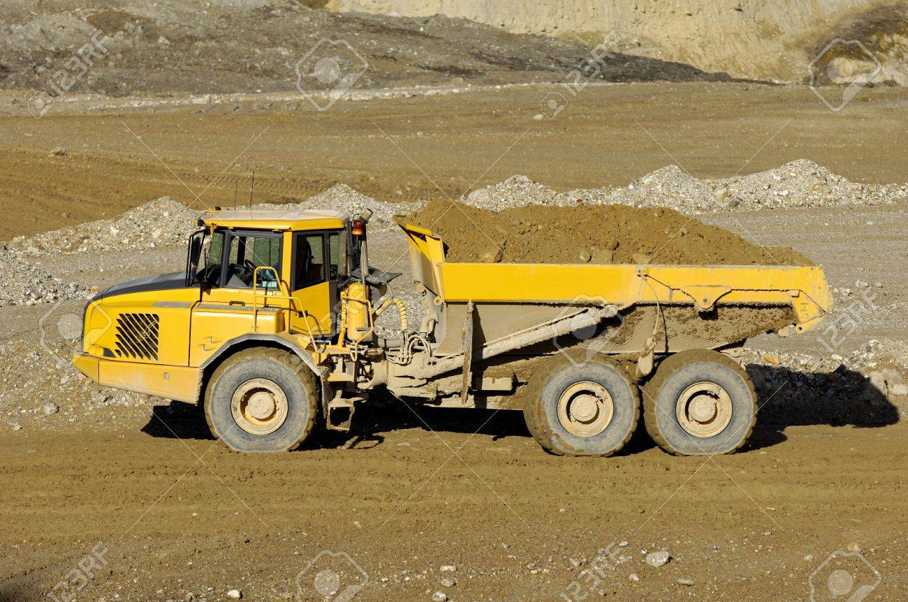 A yellow dump truck is driving in mine Stock Photo - 3136211