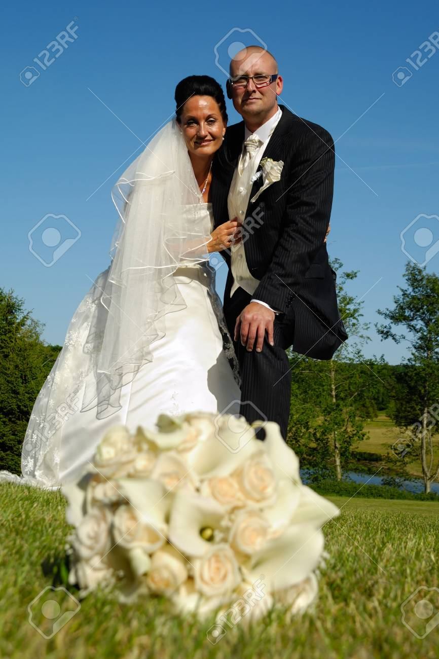 Wedding couple in focus and flower bouquet in blur Stock Photo - 3236659