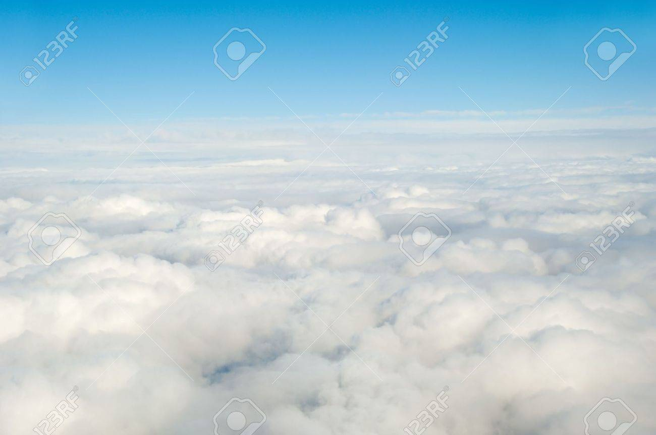 White clouds taken form above while flying in a plane. Stock Photo - 6811226