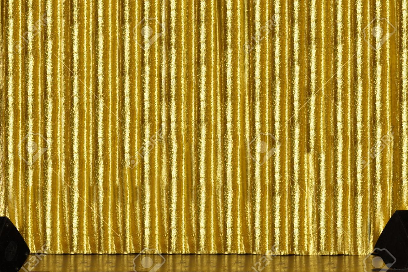 Gold stage curtain - A Stage With Golden Curtain And Spakers Stock Photo 8127410