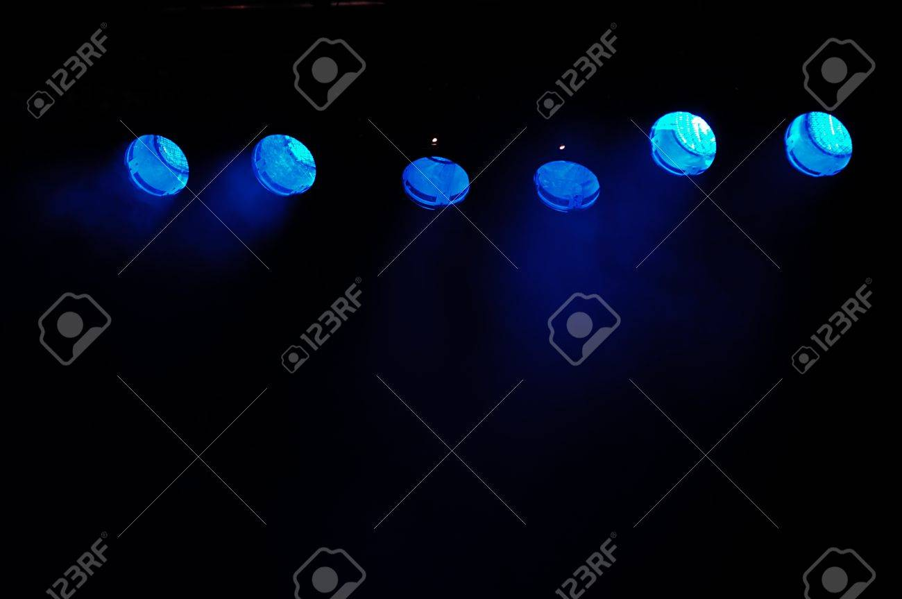 Lights and smoke. Row of blue spotlights from a stage. Stock Photo - 9819620