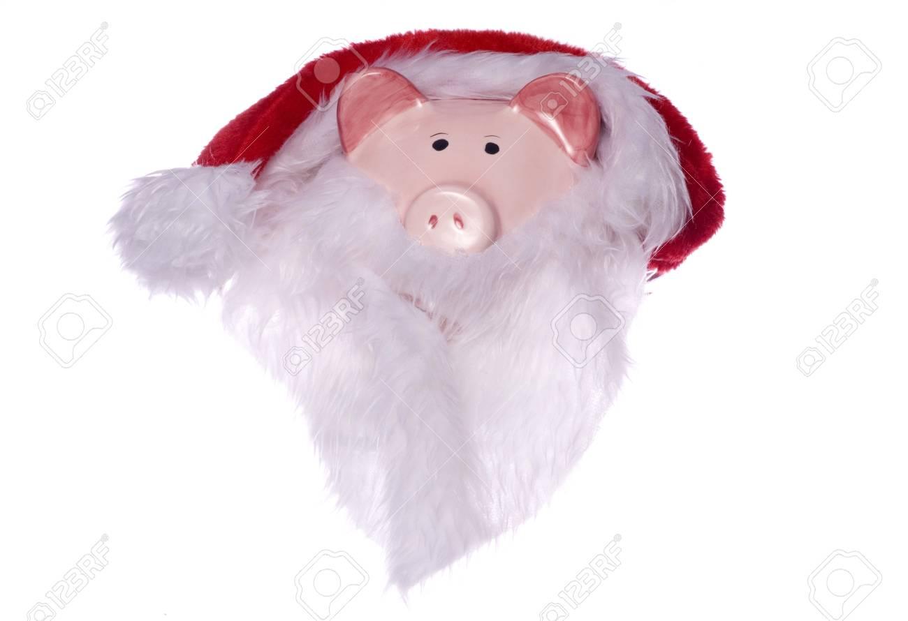 ab7bfe3f7c9 Piggy bank wearing a santas hat and beard cutout Stock Photo - 17544777