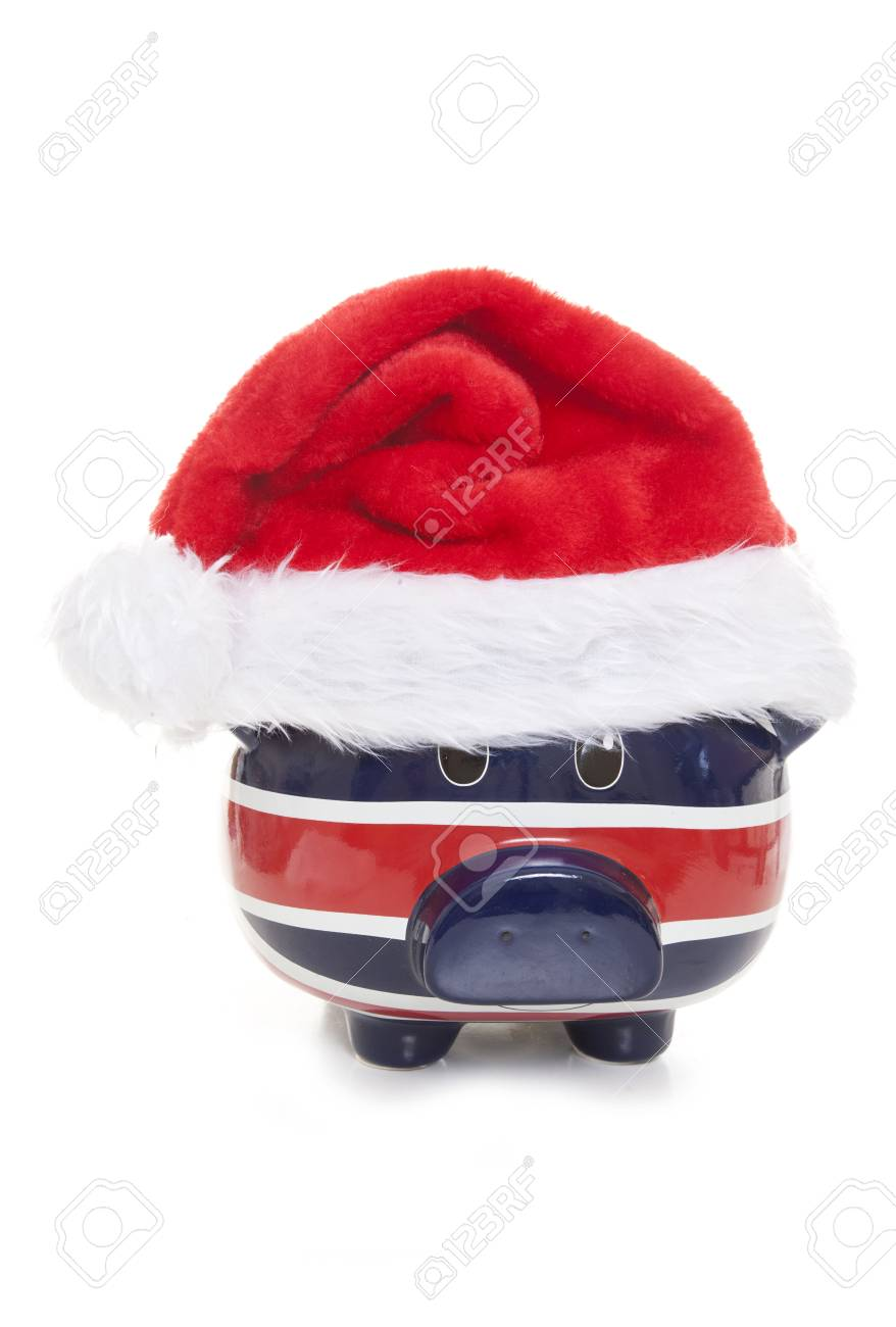 86b3fdc9c6 piggy bank wearing a father christmas hat cutout Stock Photo - 31499781