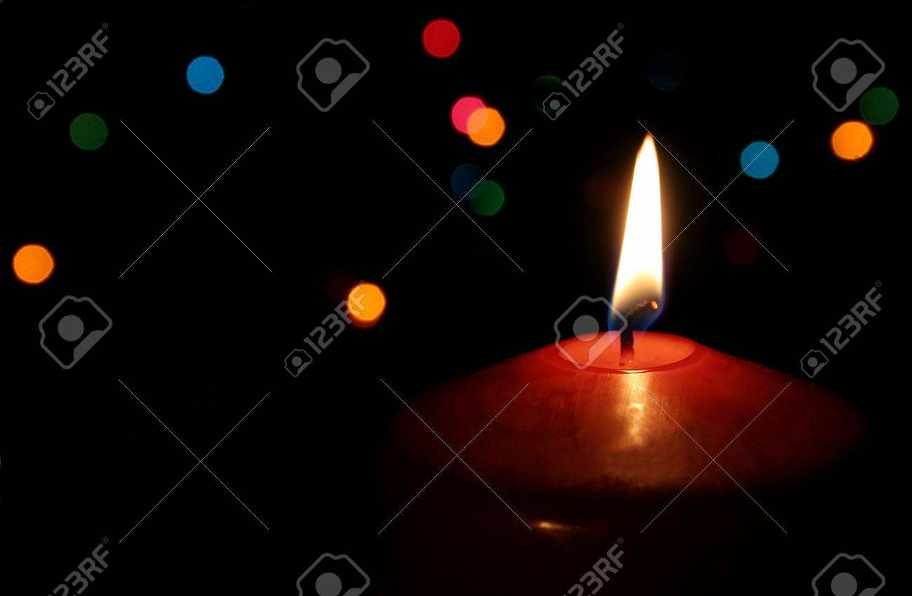 A single lit red Christmas candle. Stock Photo - 672785