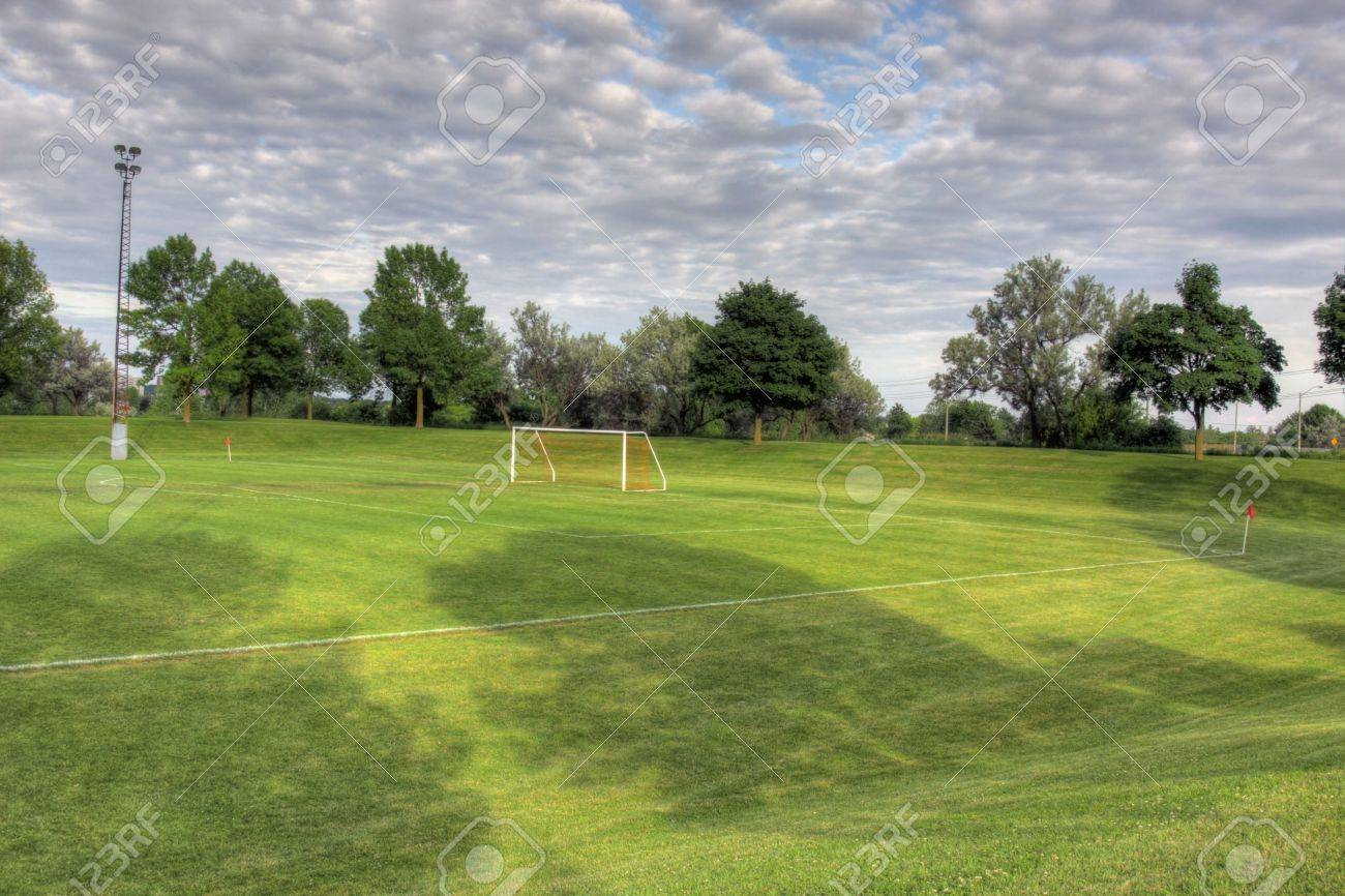 A cloudy unoccupied soccer field with trees in the background hdr a cloudy unoccupied soccer field with trees in the background hdr photograph reklamn thecheapjerseys Image collections