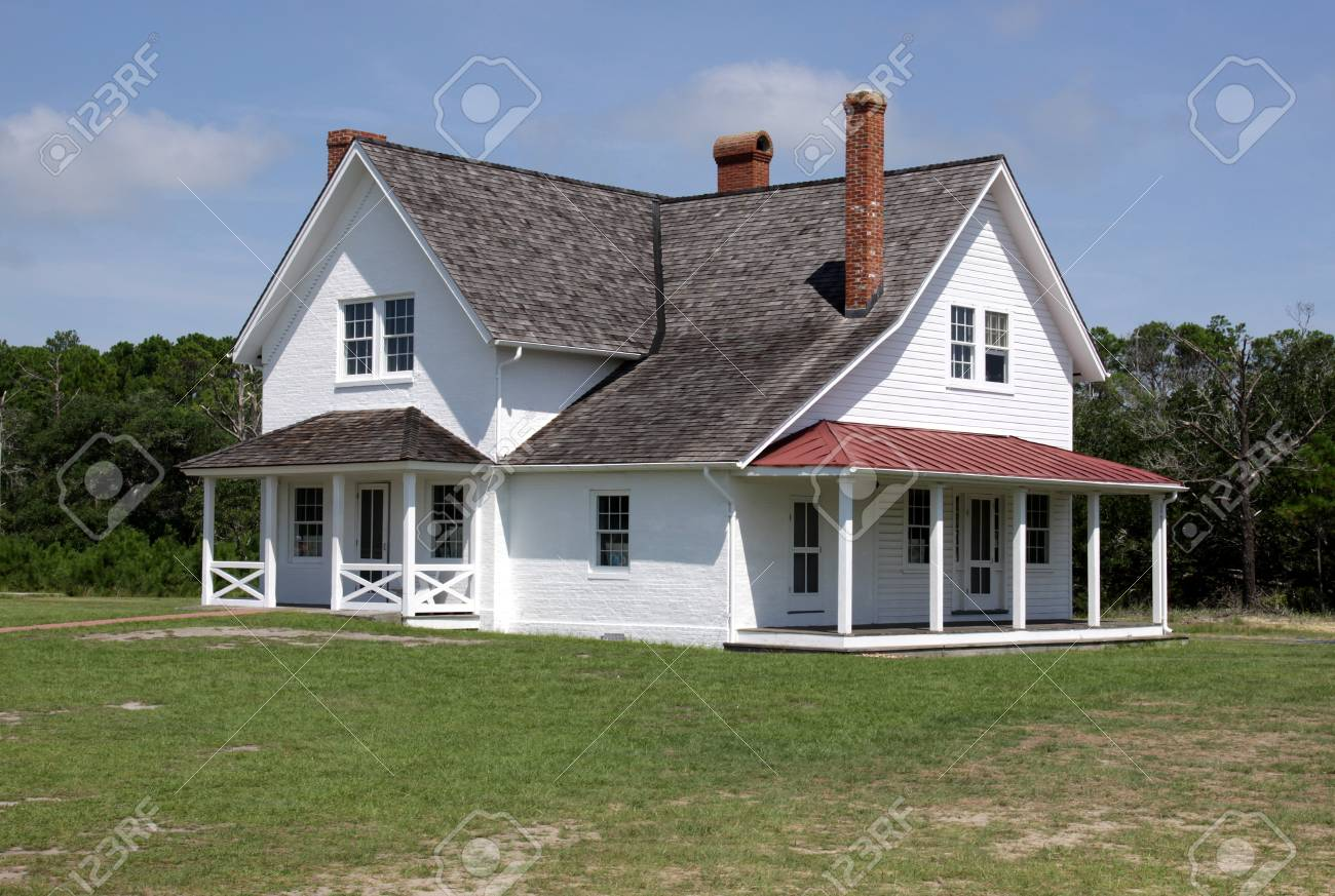 A Large Colonial Style House Sitting In The Sunshine Stock Photo