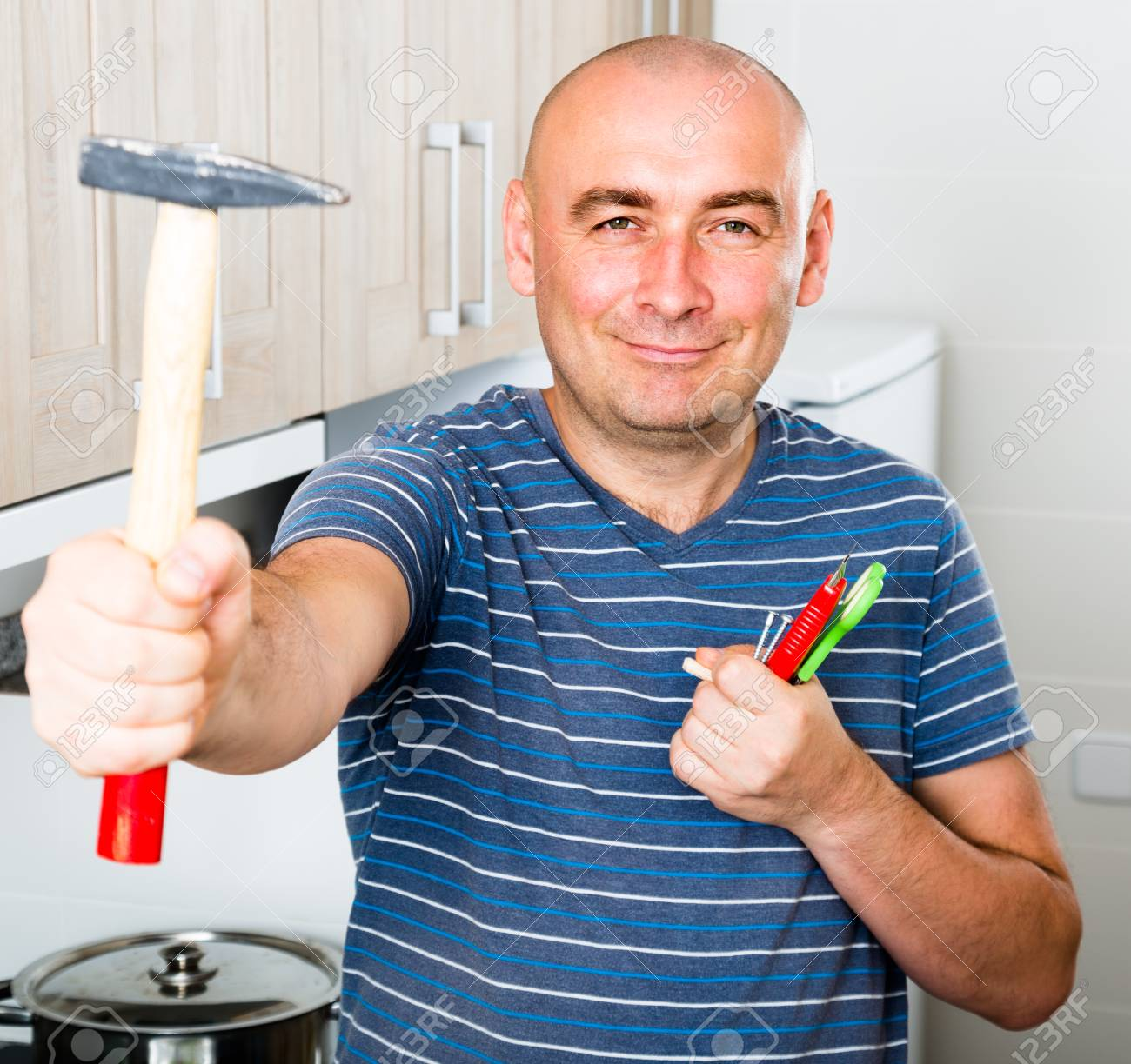 Ordinary Guy Posing With A Hammer In His Hands Stock Photo, Picture ...