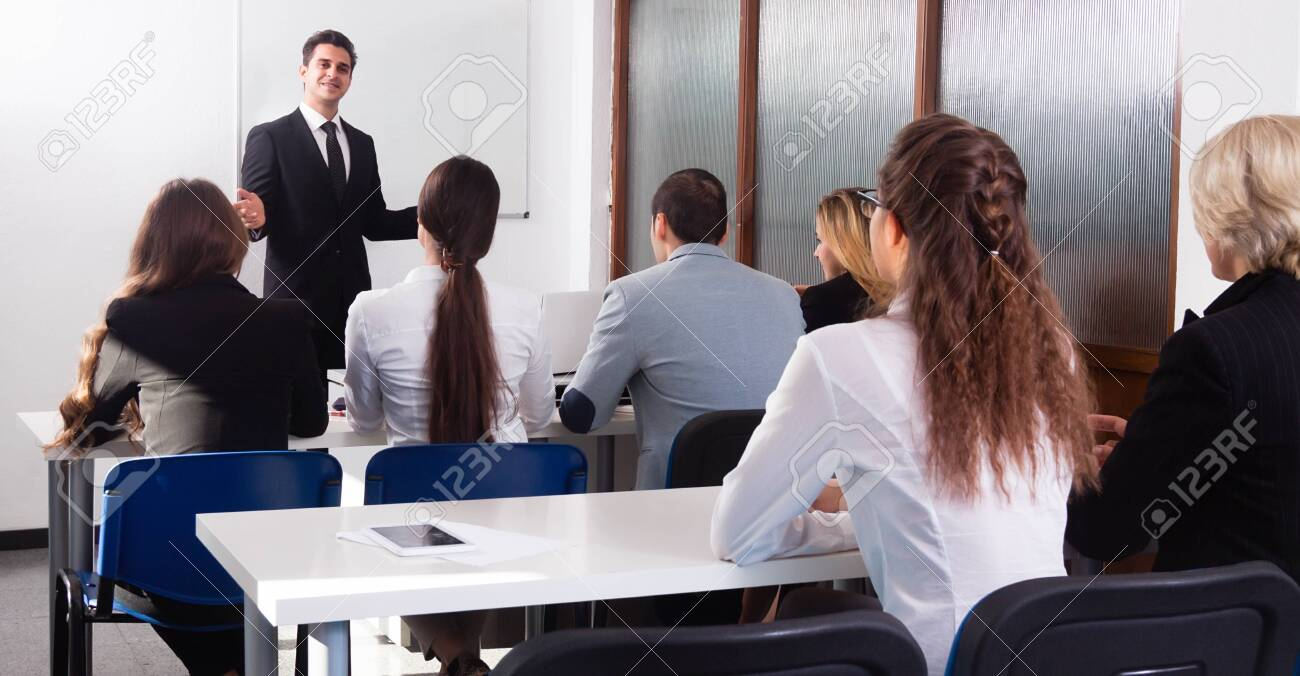 Students listen to lecture in audience - 152768031