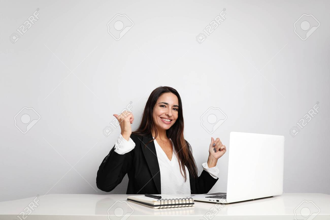 Office secretary young lady posing on the white wall and showing her notebook. Co-working. - 139408024