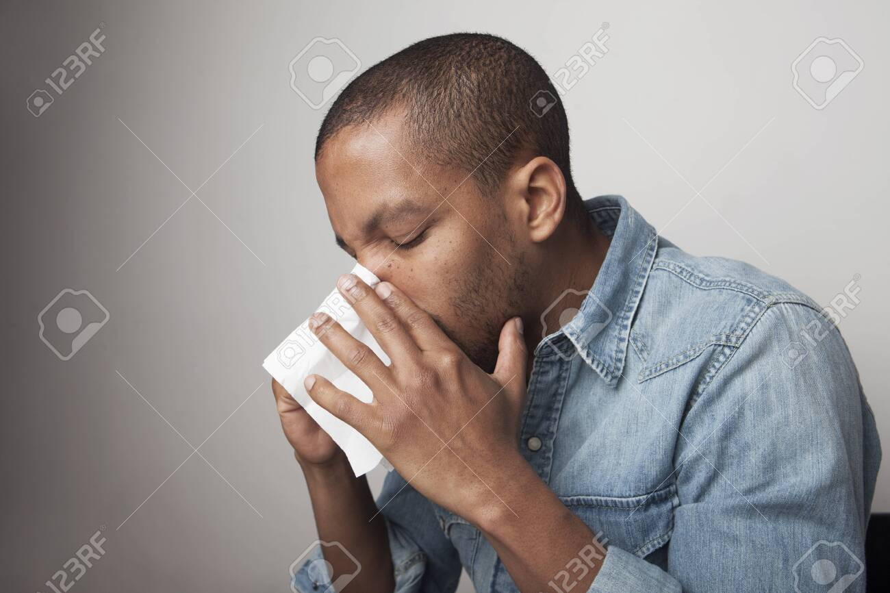 Scared black male cries, being scared of something, poses against white studio background, expresses anxiety and fear. - 144311282