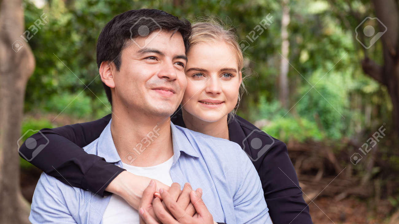 Young romance couple relax in the park - 148628811