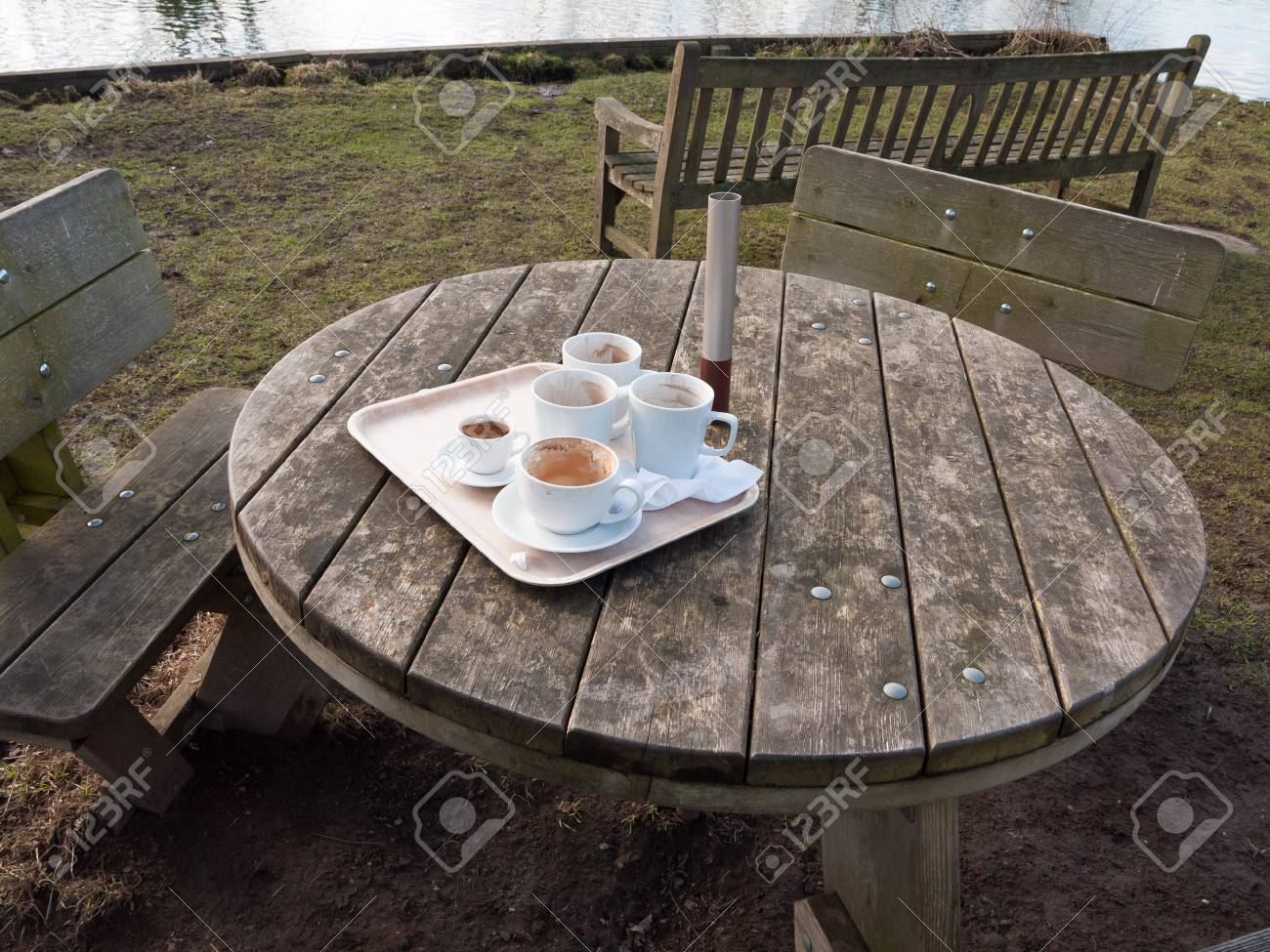 used white cups on tray on wooden table outside cafe essex stock