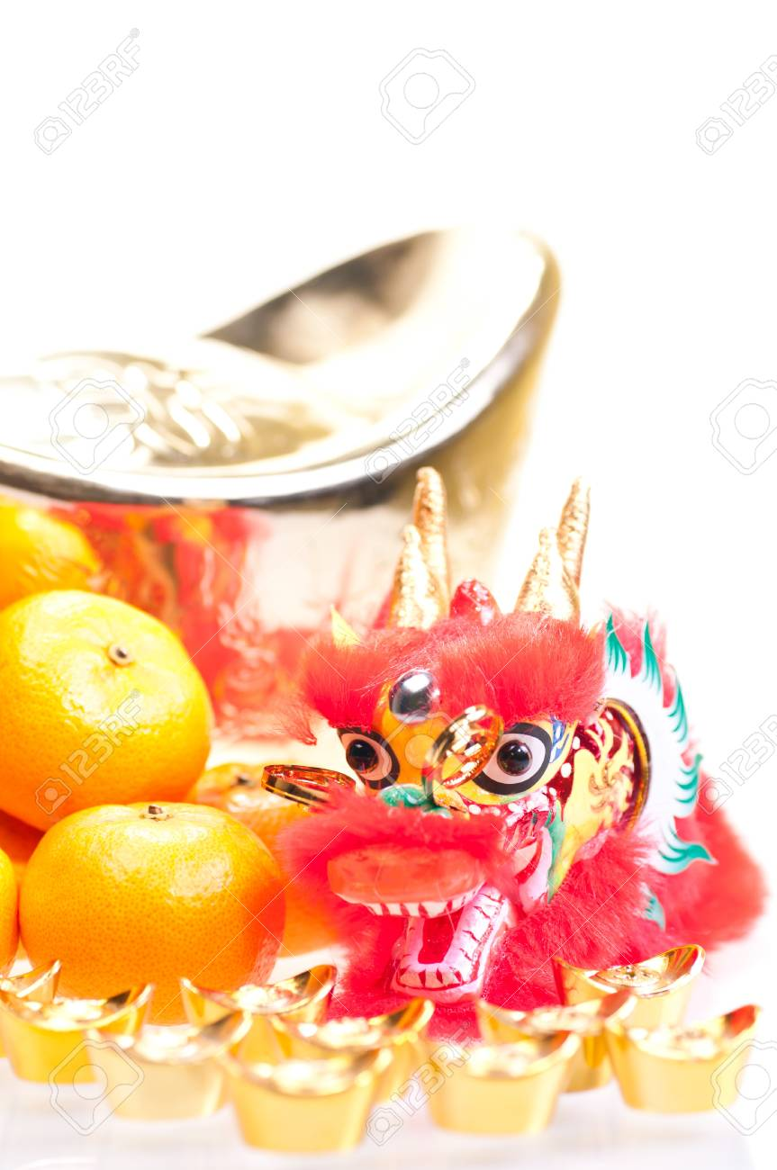 Chinese new year with dragon decoration, large gold ingot and mandarin oranges Stock Photo - 11374293
