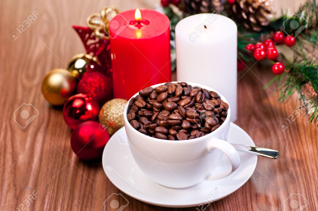 Coffee Christmas Ornaments.Christmas Cup Of Coffee Beans With Candles And Ornaments Over