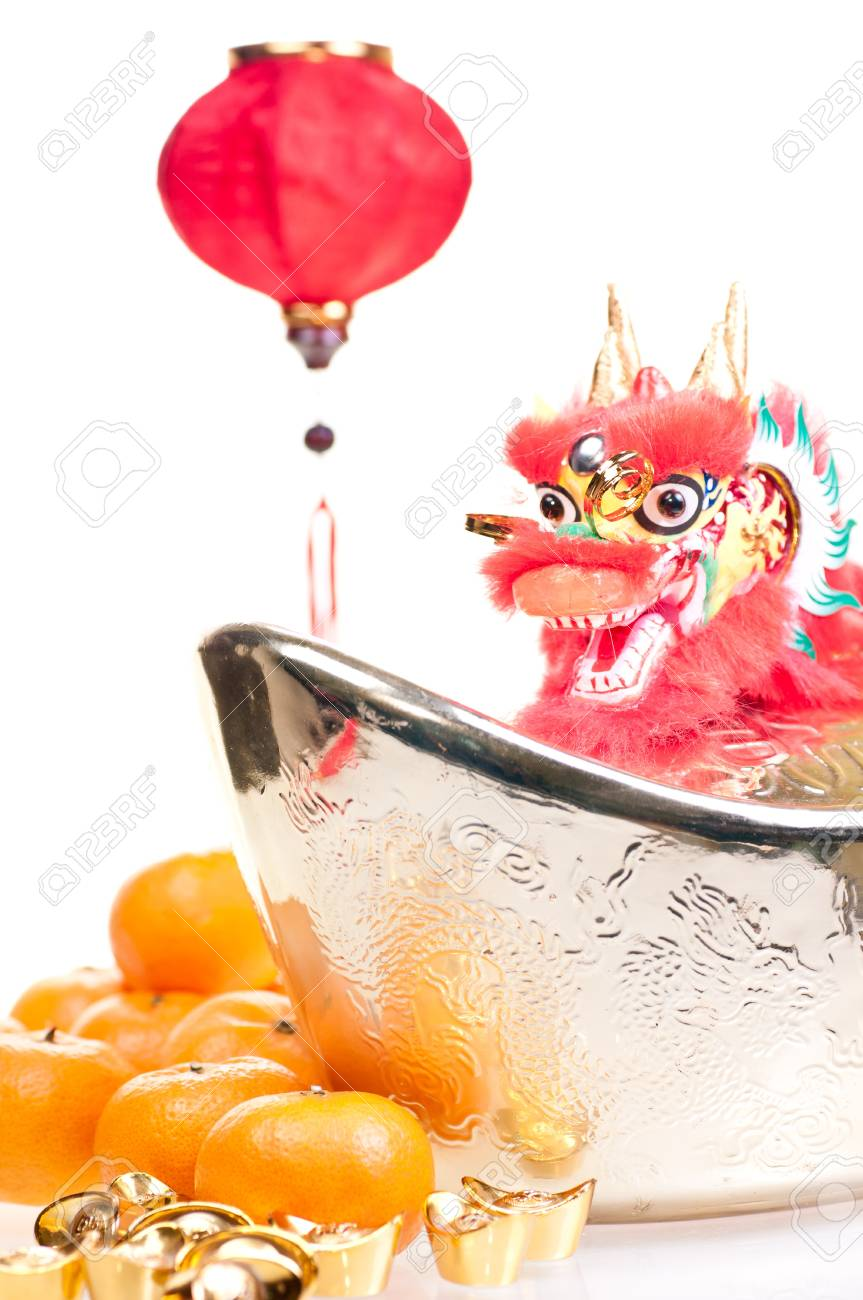 Chinese new year with dragon decoration, large gold ingot,red lantern and mandarin oranges Stock Photo - 11374356