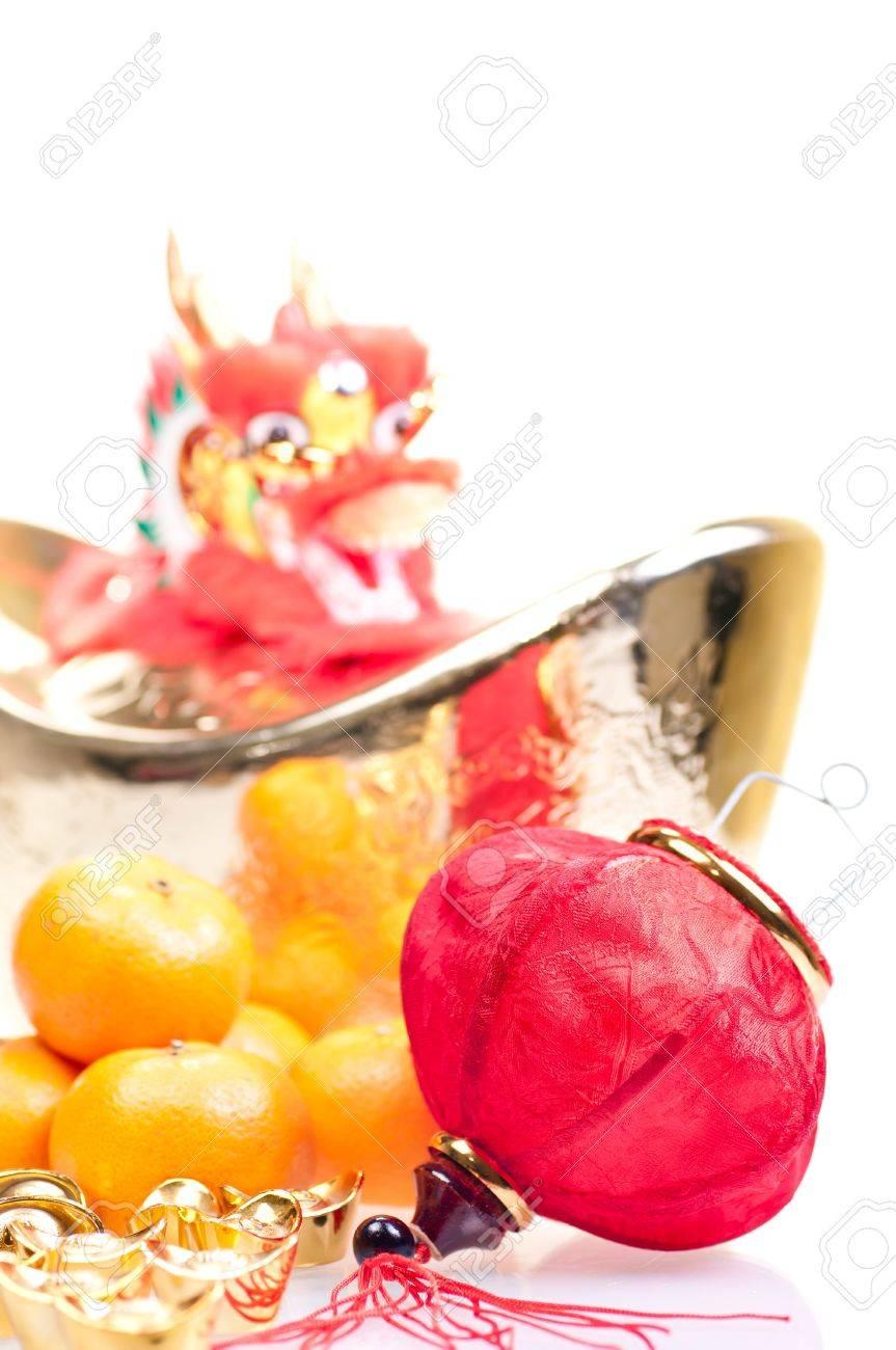 Chinese new year with dragon decoration, large gold ingot,red lantern and mandarin oranges Stock Photo - 11374357
