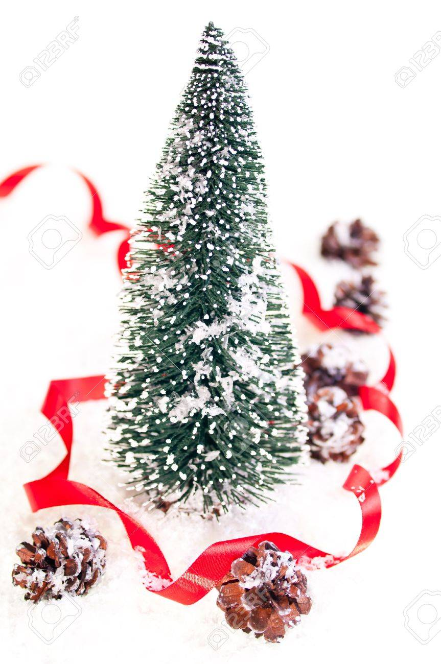 Mini Christmas Tree With Pinecones On Snow And A Red Ribbon Stock Photo Picture And Royalty Free Image Image 11374362