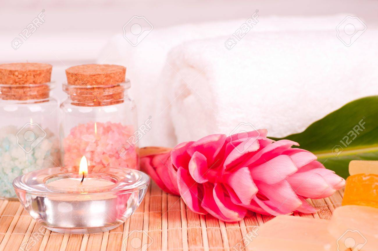 Spa Holiday With A Pink Ginger Flower In A Hotel Room Stock Photo
