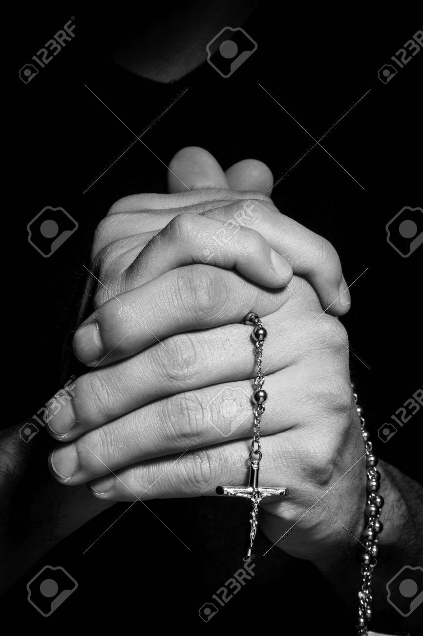 praying hands with rosay in black background stock photo picture