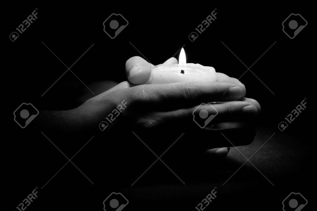 Praying Hands With Light Candle In Dark Background Black And Stock Photo Picture And Royalty Free Image Image 60120293