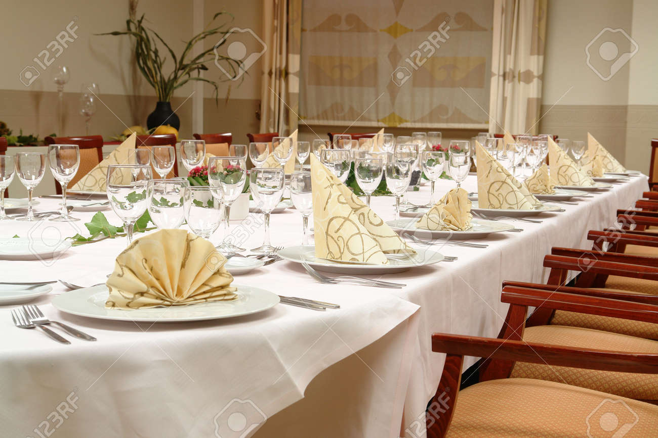 Large Dinner Table Set Up For A Lot Of People