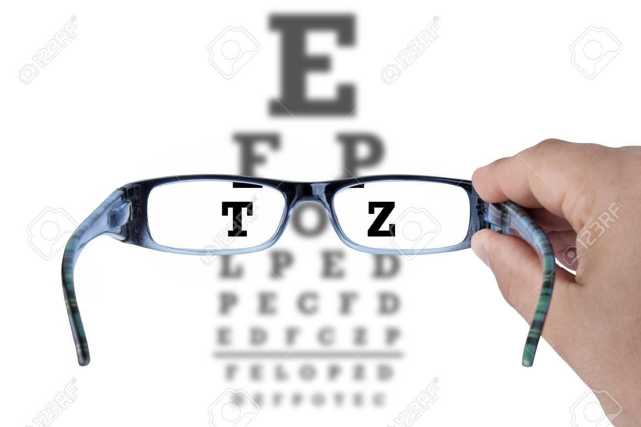 Hand holding glasses and reading eye chart test vision on white hand holding glasses and reading eye chart test vision on white stock photo 45598551 nvjuhfo Image collections