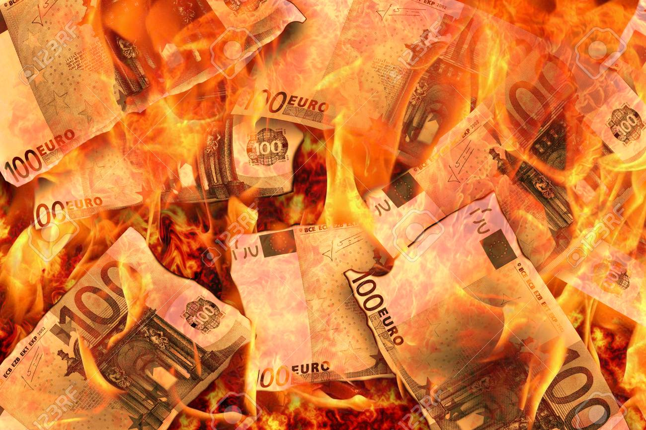 100 euro banknotes burning in flames - 104154249